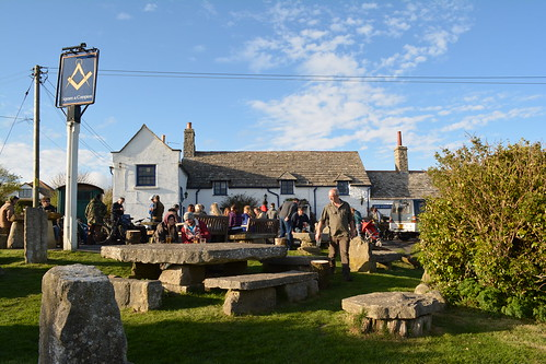 People enjoying a drink outside the Square and Compass pub in Dorset