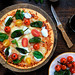 Padrón peppers, cherry tomatoes and basil pizza