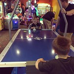 Archer's a natural at air hockey. by bartlewife