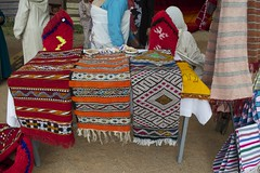 Traditional pile rugs, belts and cushions