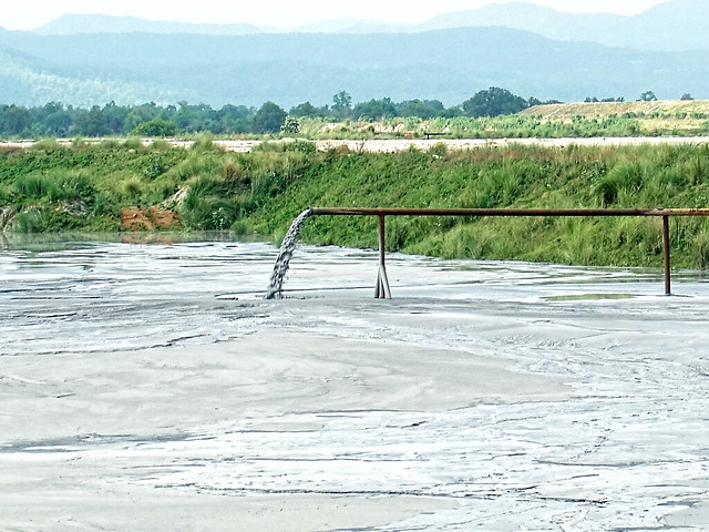 Fly-ash slurry dumped in fly-ash dam near BALCO in Korba.