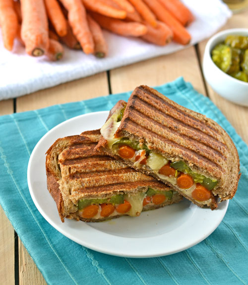A roasted carrot grilled cheese on a white plate