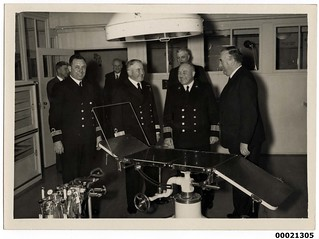 Royal Australian Navy officers and Prime Minister Menzies on board TSS ORANJE II
