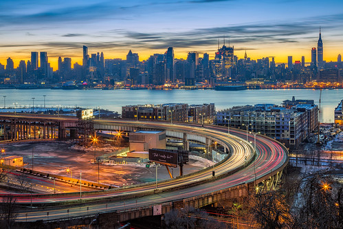 city nyc newyorkcity travel sky motion water metal skyline architecture skyscraper sunrise buildings print photography photo newjersey scenery gallery cityscape unitedstates image cloudy manhattan fineart scenic nj picture tunnel canvas esb empirestatebuilding weehawken traffictrails mikeorso