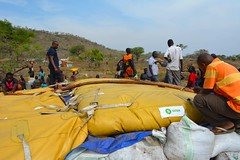 Bringing water to South Sudanese refugees in Uganda - Nyumanzi 1 refugee camp - Oxfam water bladders