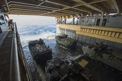 Amphibious assault vehicles prepare to launch from the well deck of amphibious dock landing ship USS Ashland (LSD 48). (U.S. Navy/MCSN Raymond D. Diaz III)