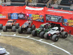 tractor pulling(0.0), stock car racing(0.0), dirt track racing(0.0), sprint car racing(0.0), race track(0.0), auto racing(1.0), racing(1.0), sport venue(1.0), vehicle(1.0), sports(1.0), race(1.0), motorsport(1.0), off-roading(1.0), monster truck(1.0),