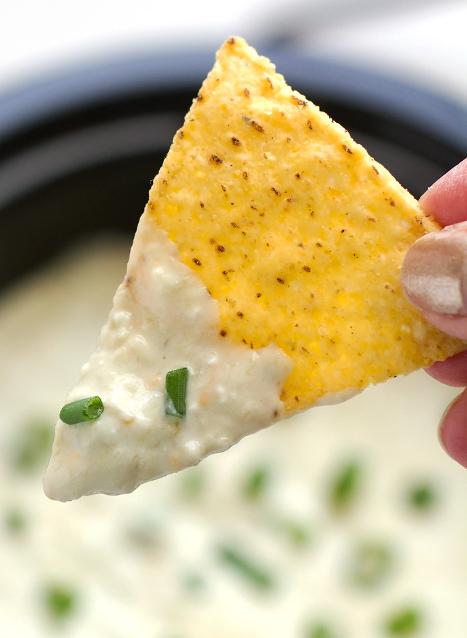 5 Ingredient Slow Cooker Queso Dip - Toss is all in and sit back because this dip is going to make itself! #queso #quesoblanco #slowcooker #crockpot #salsaverde   littlespicejar.com