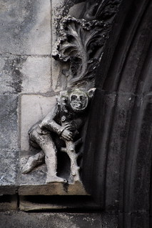 XV-XVIth Century STONE SCULPTED  ANTHROPOMORPHICAL CREATURE,OR MAYBE A JOKER. BOTH SCULPTURES AT EACH SIDE OF THE BASE OF A HUGE NORTHERN WINDOW:ST JEAN CHURCH-CAEN-NORMANDY-FRANCE Feb 13th 2015