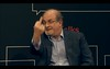 Sir Salman Rushdie at NYT TimesTalk 20130503 - pix 02 discussing and giving the Ai Weiwei finger