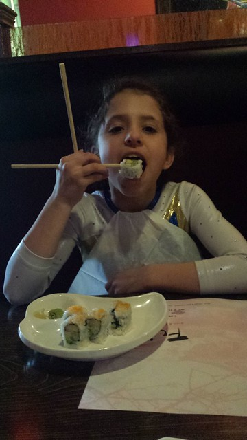 Annie ate sushi after her great scores at her gymnastics meet!