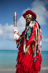 Mr Maskanoo poses with the Queen's Baton, in Grace Bay, Turks and Caicos Islands, Wednesday 16 April 2014. Turks and Caicos Islands is nation 56 of 70 nations and territories the Queen's Baton will visit....