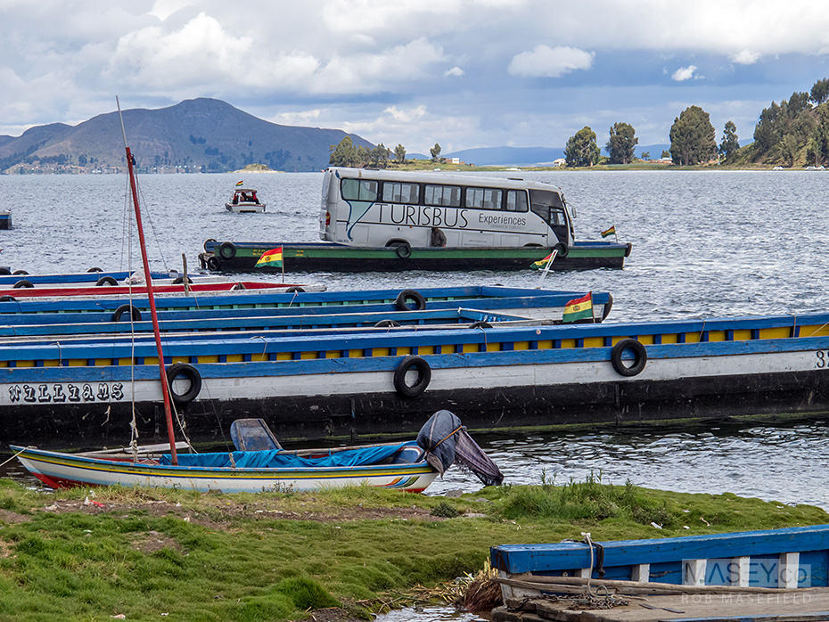 Departing Peru via water, and on a separate barge to our bus.