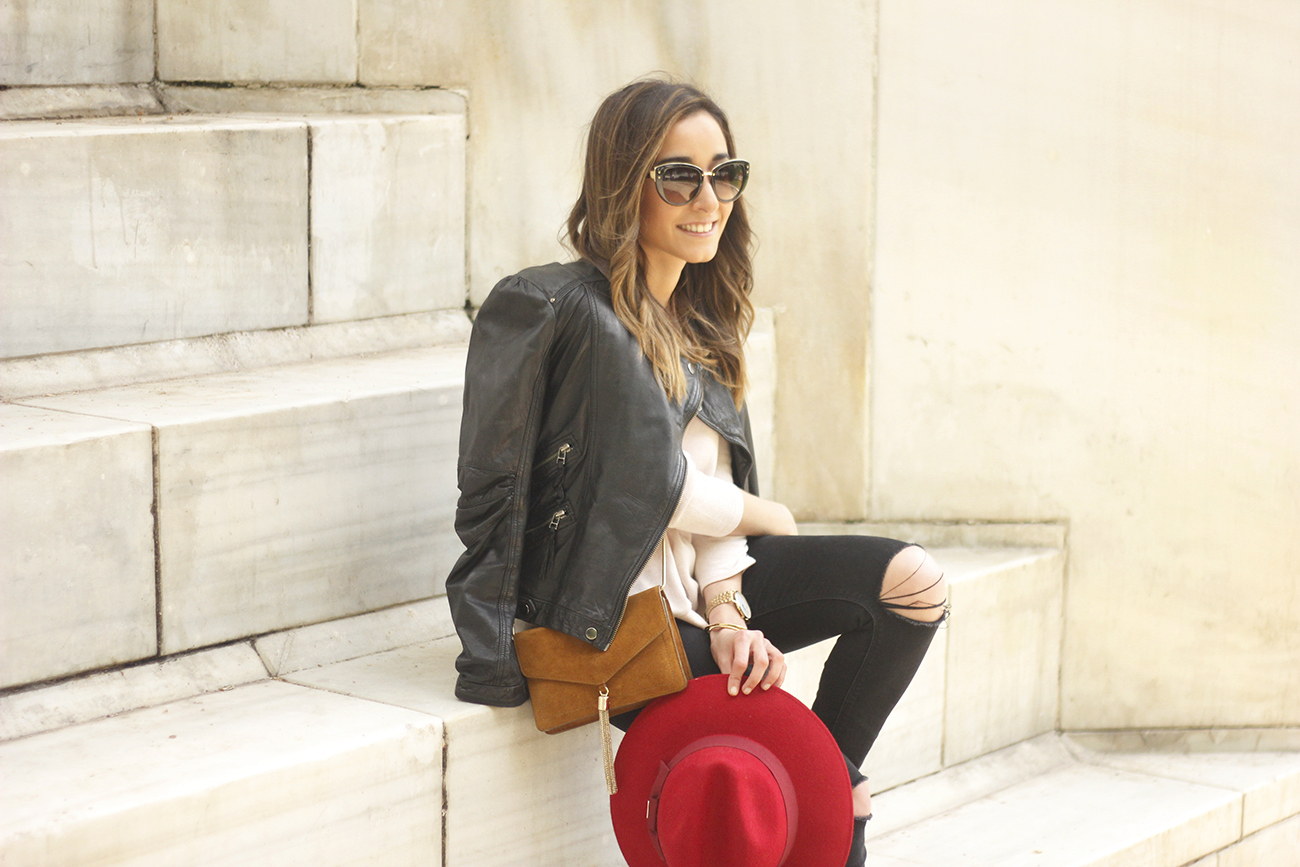 black biker jacket ripped jeans red hat camel bag outfit fashion style spring12