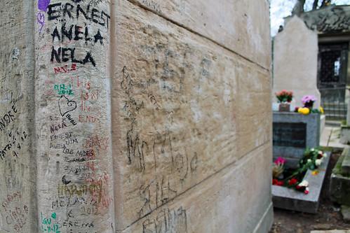 Graffiti and Jim Morrison's grave at Père Lachaise Cemetery