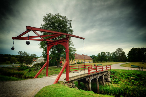 bridge trees house castle history grass car landscape wooden chains rocks iron arch sweden path stones balls bikes bicycles greenhouse historical balance sverige benches fortress railings spheres vignette renaissance hdr gravel gripsholm slott mariefred