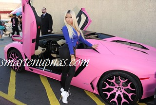 Nicki Minaj stunting in her pink lambo at the launch of her Kmart line
