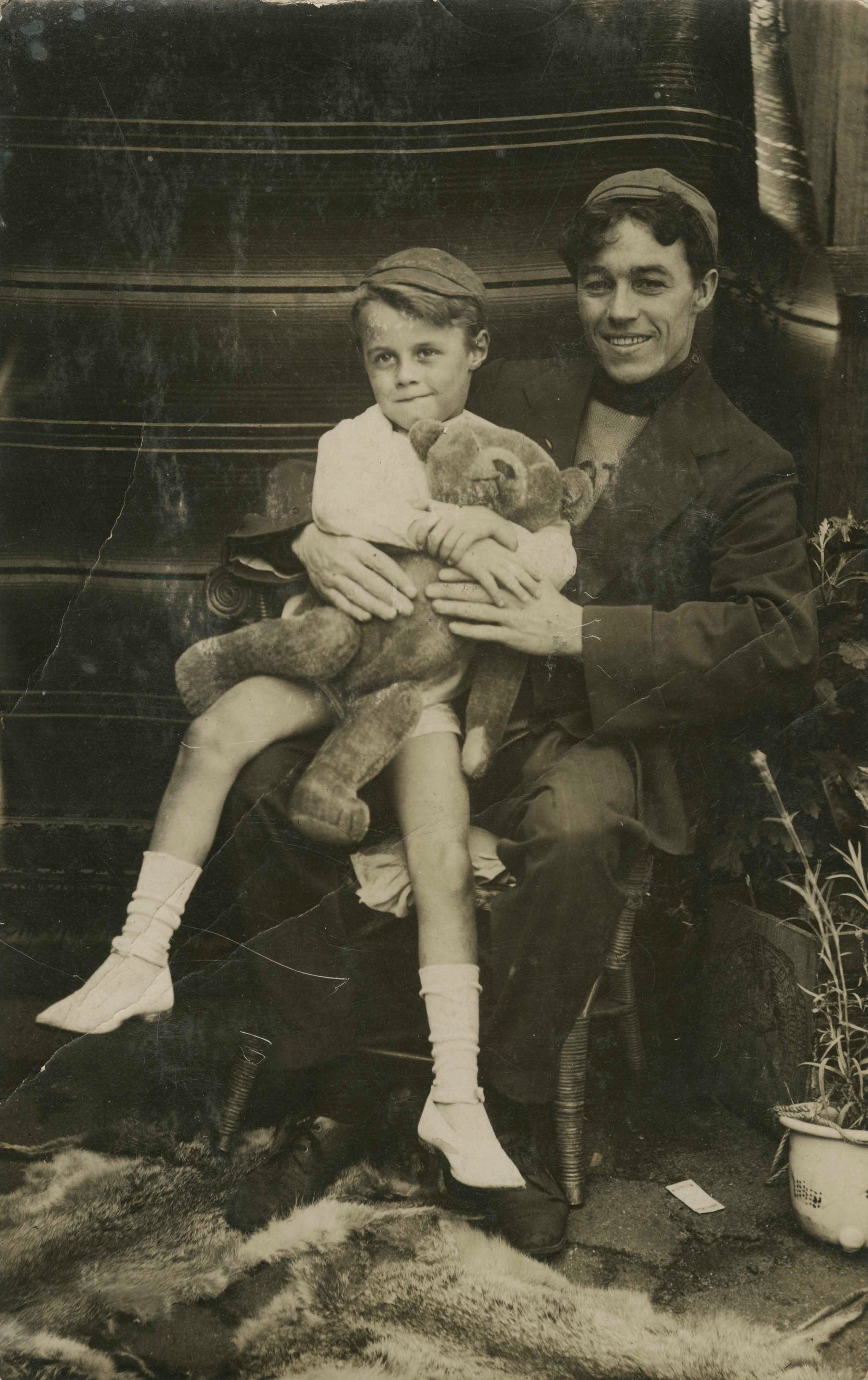 Photographic postcard of a man, a young boy and a teddy bear