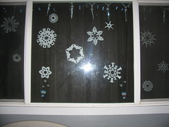 Icicle lights at home-- now with paper snowflakes!