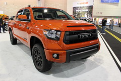 automobile(1.0), automotive exterior(1.0), toyota(1.0), pickup truck(1.0), sport utility vehicle(1.0), wheel(1.0), vehicle(1.0), truck(1.0), toyota tundra(1.0), rim(1.0), auto show(1.0), off-road vehicle(1.0), bumper(1.0), land vehicle(1.0), motor vehicle(1.0),