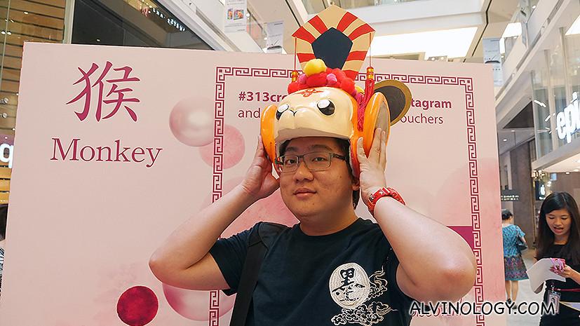 Alvin tries on the Monkey headdress
