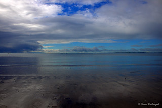 Image of Browns Bay Beach. new blue sea newzealand sky cloud brown white seascape water clouds dark bay sand mud tide horizon north auckland zealand shore northshore browns nz muddy brownsbay