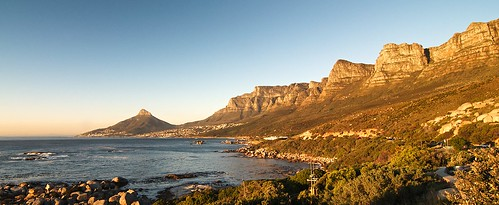 rogersmj posted a photo:	Approaching Cape Town at sunset from our day drive down the peninsula, we rounded a corner and were greated with the golden cliffs of Table Mountain. Camps Bay, center, is where we stayed while in Cape Town.The city's downtown lies just over the ridge above Camps Bay, between Table Mountain and Lion's Head (the solitary peak left of center).