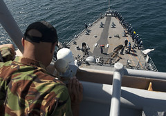 A New Zealand Army engineer looks on as USS Pearl Harbor (LSD 52) departs the Republic of Kiribati, July 26. The ship and embarked international Pacific Partnership team arrived in the Solomon Islands July 29. (U.S. Navy photo by Mass Communication Specialist 2nd Class Tim D. Godbee)