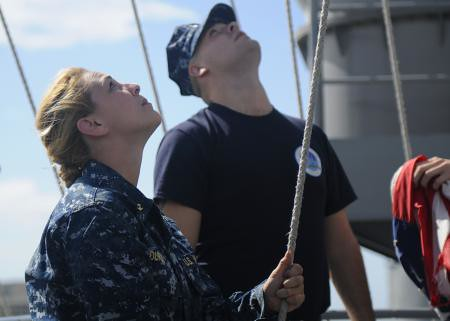 Midshipman 1st Class Maura Durso raises the ship's call sign as U.S. 7th Fleet flagship USS Blue Ridge
