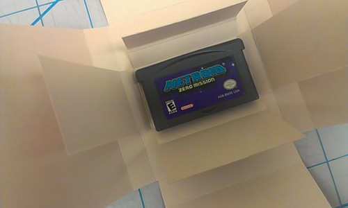 Game cartridge in opened box