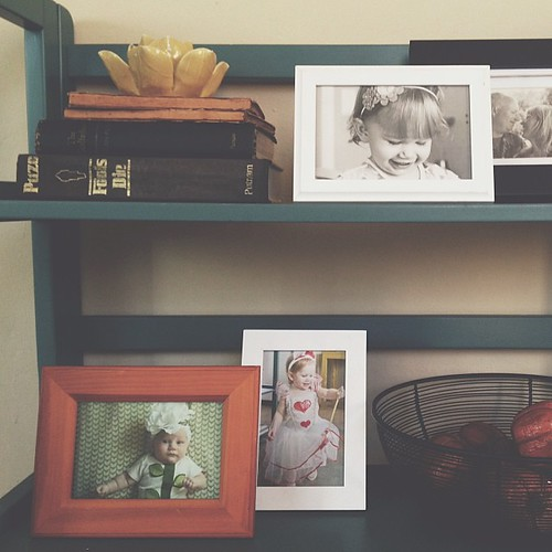 Inspired by Gretchen Rubin's tradition of putting up framed photos of her daughters in their Halloween costumes each year. Only 2 so far, but I think this is such a sweet idea. :) #cornersofmyhome #happinessproject
