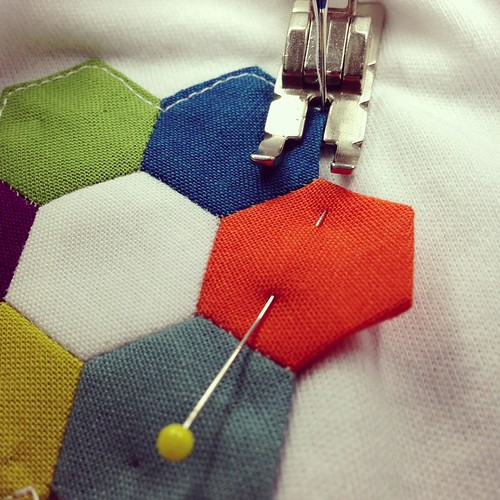 Machine stitching tiny hexies to a onesie