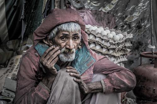poverty pakistan portrait man children hope eyes faces tea poor smoking eggs aged frustration punjab desperation ghetto chai salesman hardworking