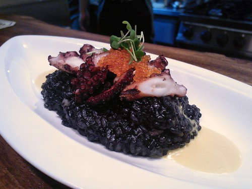 Grilled octopus, squid ink risotto, salted egg sauce, tobiko, wasabi sprouts