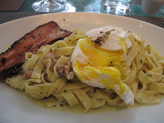 Farm Egg Carbonara housemade pepper bacon, poached egg parmesan at Boulud 3
