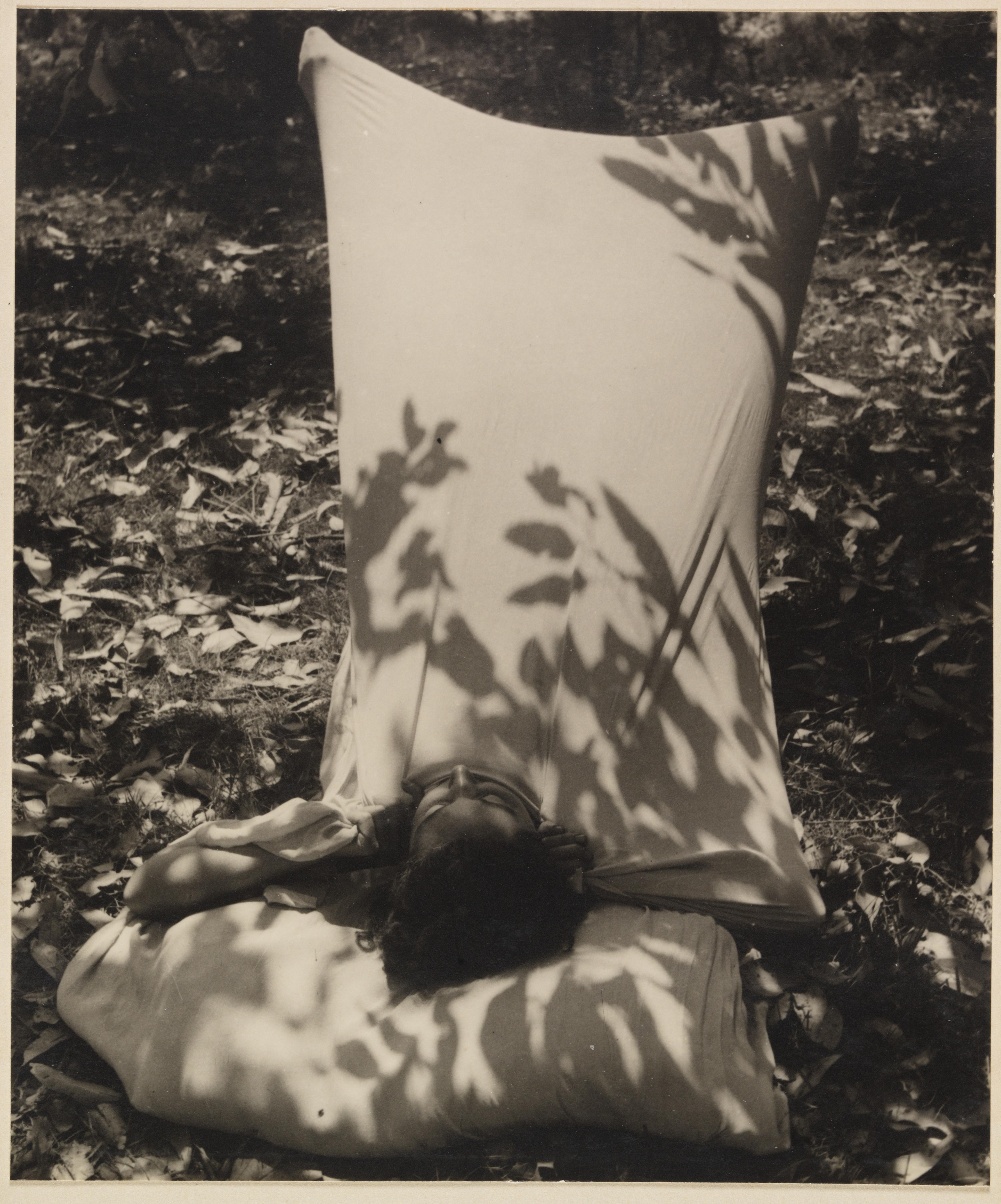 Woman in sleeping bag from Camping trips on Culburra Beach by Max Dupain and Olive Cotton