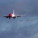 Wing flap vortex during stormy approach by David Peacock Photoart