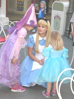 Alice chats with a couple of little princesses.