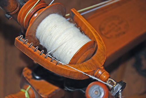 Spinning natural Columbia wool roving on Canadian Production Wheel