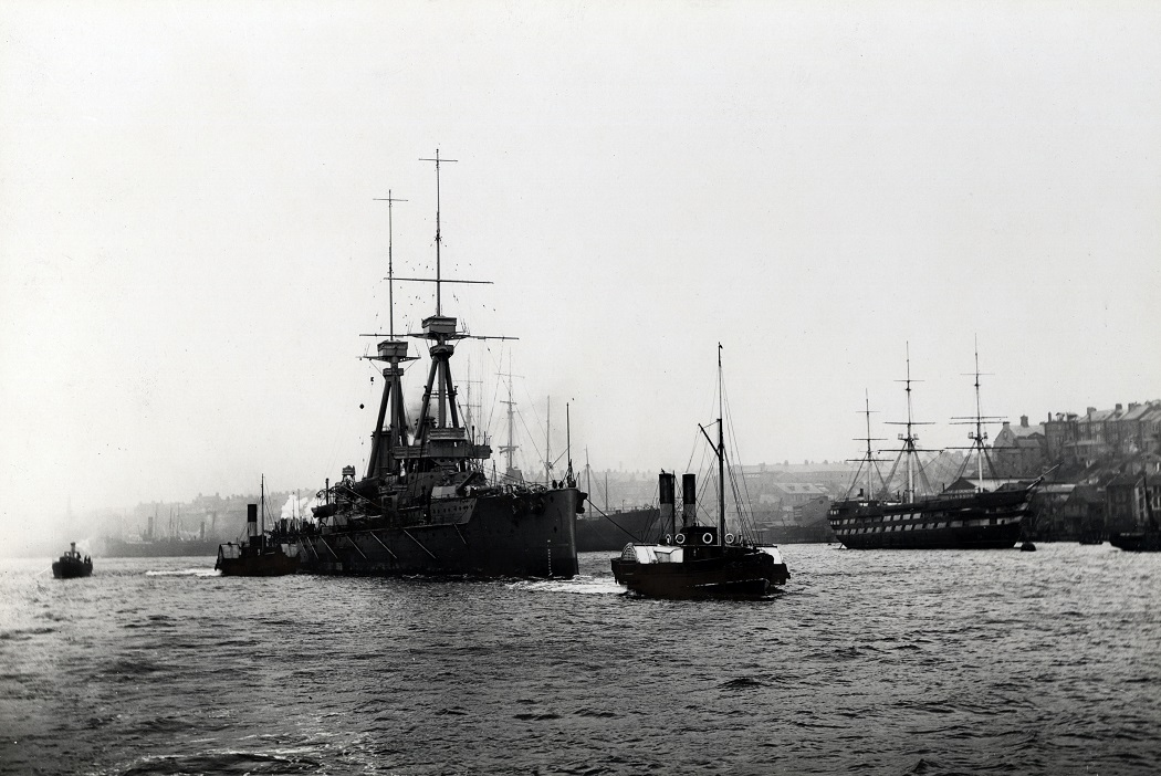 The battleship HMS 'Superb' passing North Shields