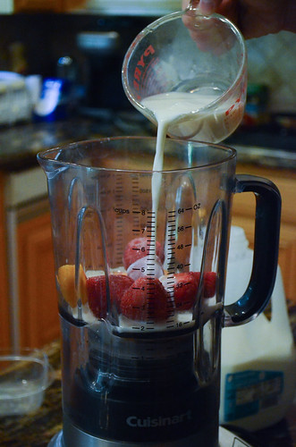 Milk is poured into the blender.