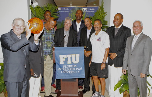 Dean Rock holds a basketball signed and presented to him by NBRPA Legends of Basketball at the announcement of the partnership between FIU Health and the National Basketball Retired Players Association