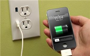 Apple iPhone charging at wall USB port