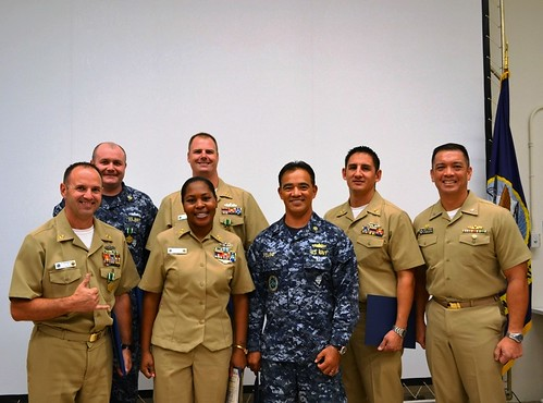 PEARL HARBOR - Capt. John Figuerres, commanding officer of Afloat Training Group Middle Pacific, stands with awardees.