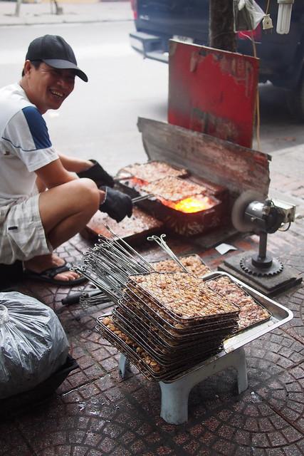 street-side meat-griller. Hanoi, Vietnam