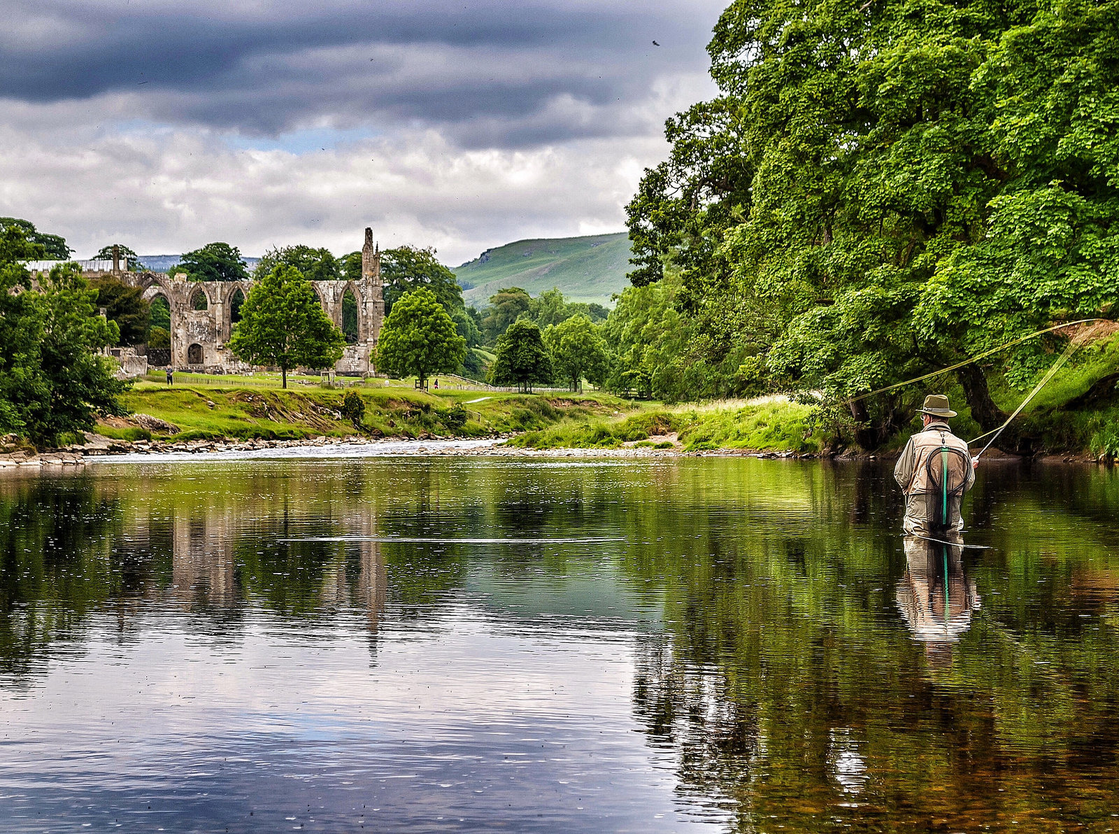 Fly Fishing in the River Wharfe next to Bolton Abbey, Wharfedale. Credit Carl Milner