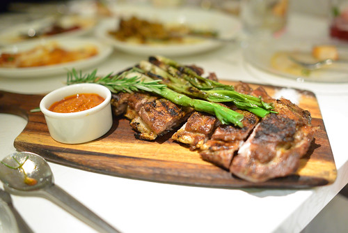 Costillas De Cordero Con Romesco grilled lamb ribs with romesco sauce and green onions