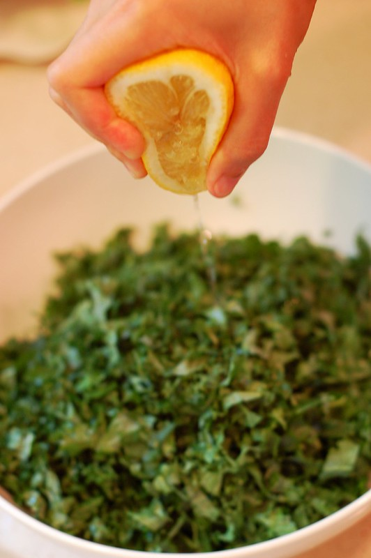 Squeezing lemon onto the chopped kale by Eve Fox, the Garden of Eating blog, copyright 2013by Eve Fox, the Garden of Eating blog, copyright 2013