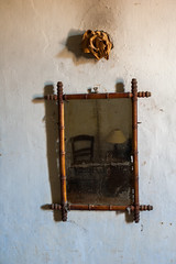 The old mirror in the old bedroom
