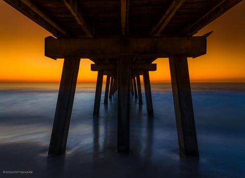 ocean bridge blue light sunset shadow sea orange blur water silhouette yellow pier surf waves glow unitedstates florida wave naples fl naplespier hanusiak